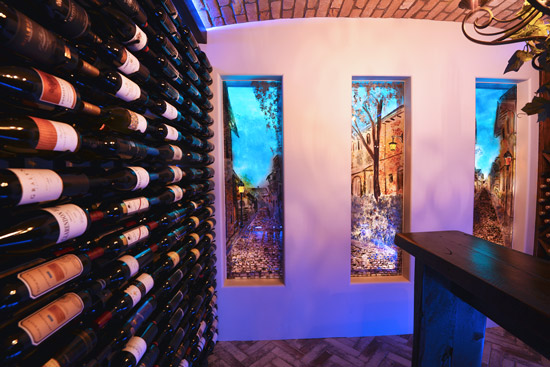 Feature glass panels in french themed wine cellar.