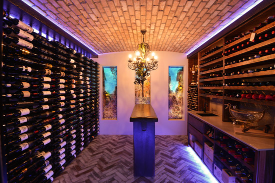 Glass art panels in custom wine cellar