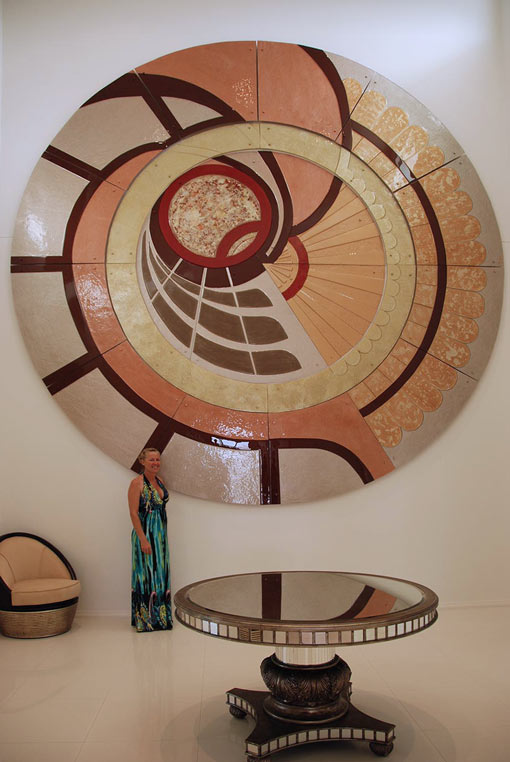 Large round artistic glass feature wall panel.
