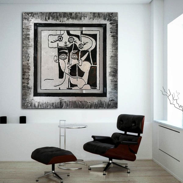 Abstract monochrome glass wall art with black leather swivel chair and foot stool.