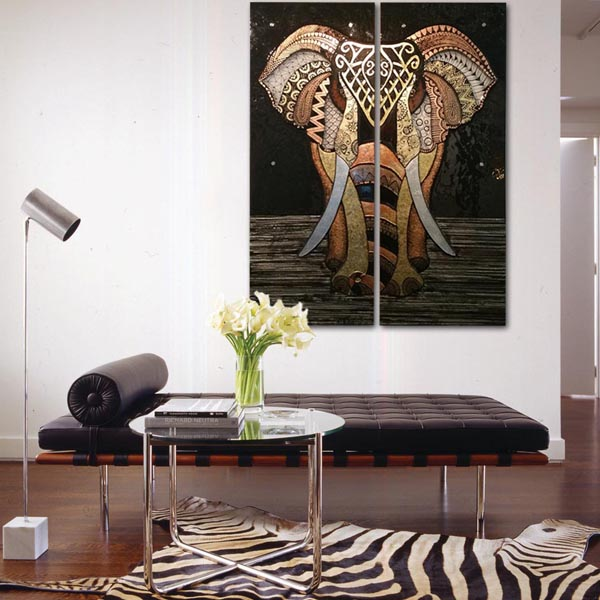 Bronze elephant wall art in African style living room.